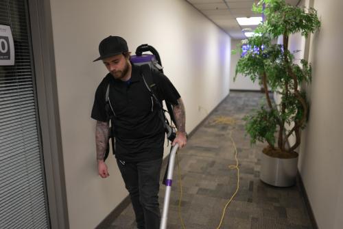 Person vacuuming hallway